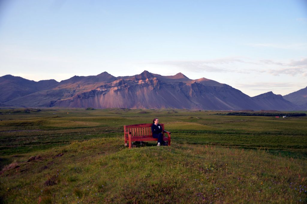 Deb enjoyed sitting on the bench on the hill next to the Aurora cabins in Hofn Iceland